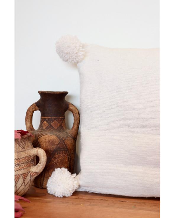 Coussin pompon blanc